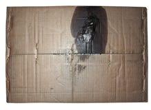 brązowić panwiowego kartonowego tekstury tło z motorową nafcianą plamą odizolowywającą nad bielem Obraz Royalty Free