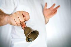 Brązowy dzwon w ręce Obrazy Royalty Free