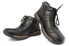 brązowy kolor buta człowiek dwa białe skórzana od ciemnej strony zimy. Zdjęcia Royalty Free