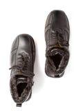 brązowy kolor buta człowiek dwa białe skórzana od ciemnej strony zimy. Obrazy Royalty Free