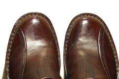 brązowe odizolowanych skórzane buty. Obrazy Royalty Free