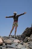 Braços abertos da mulher na cruz Fotografia de Stock Royalty Free