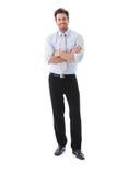 Braços de sorriso do homem de negócios confiável cruzados foto de stock
