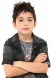Braços do menino dos anos de idade do retrato oito cruzados fotografia de stock