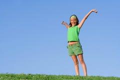 Braços felizes da criança levantados Fotos de Stock Royalty Free