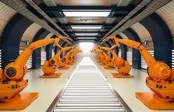Braços robóticos com linha do transporte Imagens de Stock Royalty Free