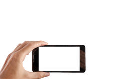 Brać obrazek z wiszącą ozdobą, mądrze telefon z ścinek ścieżką dla ekranu Zdjęcia Royalty Free