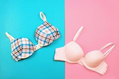 Bra on hanger on two tone background Stock Photo