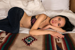 Bra and jeans Stock Images