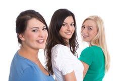 Bra lagarbete - lyckliga deltagare i utbildning i rad som isoleras på vit backg Royaltyfri Foto