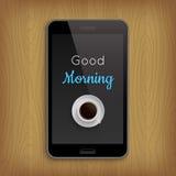 Bra morgon med kaffekoppen i telefon Royaltyfri Foto