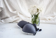 Bra, thong and lingerie with white flowers Stock Image