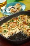 Braadpan met aardappels en rijst royalty-vrije stock afbeeldingen