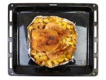 Braadstuk bij de oven gehele kip Royalty-vrije Stock Foto