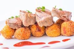 Braadstukvarkensvlees met bessaus Stock Foto