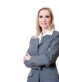 Braccia sorridenti della donna di affari attraversate fotografia stock libera da diritti
