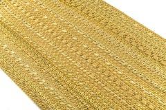 Braccialetti dorati, collane immagini stock libere da diritti