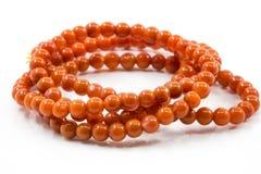 Braccialetto arancio isolato su bianco Fotografia Stock