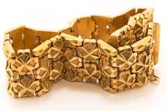 Braccialetto dorato Fotografia Stock