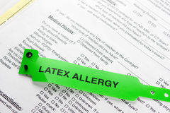 Braccialetto verde di allergia del lattice Immagini Stock