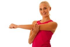Braccio adatto di allungamento della donna isolato sopra bianco Immagine Stock Libera da Diritti