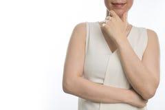 Braccio del ` s dell'incrocio uno della giovane donna asiatica e fronte sorridenti di tocco Immagine Stock
