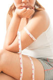 Braccio femminile con la misura di nastro Immagine Stock Libera da Diritti