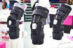Brace on knee joint with sleeve made of neoprene in store. Brace on the knee joint with a sleeve made of neoprene in store stock images
