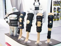 Brace on knee joint with sleeve made of neoprene in store. Brace on the knee joint with a sleeve made of neoprene in store stock photography