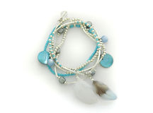 Bracelet. With silver and cyan beads Royalty Free Stock Photos