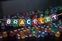 Bracelet. Letter beads on a bracelet, arts and crafts Royalty Free Stock Photo