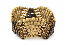 Bracelet. Made of wood and metal balls Royalty Free Stock Photo