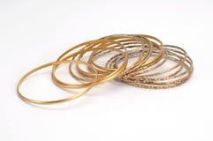 Bracelet. Gold bracelets isolated at white Royalty Free Stock Images