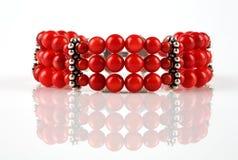 Bracelet. A red bracelet on a white background stock images