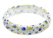 Bracelet with abstract flower decoration Royalty Free Stock Images