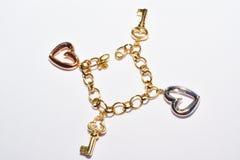 Bracelet avec le coeur et la conception de clé Image stock