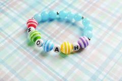 Bracelet with baby name NOAH royalty free stock photo