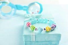 Bracelet with baby name NOAH royalty free stock image