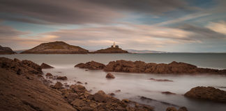 Bracelet Bay and Mumbles lighthouse Stock Images