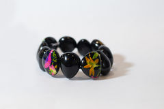 Bracelet black colorful hand. On a white fotne Stock Photography
