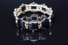 Bracelet with black  stones over black Stock Image