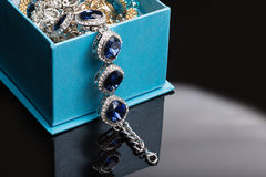 Bracelet with blue stones in a box Stock Photos