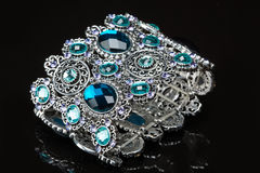 Bracelet with blue stones over black Royalty Free Stock Photography