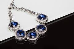Bracelet with blue stones over black Stock Photo