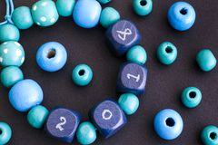Bracelet with 2018 on blue wooden beads Royalty Free Stock Images