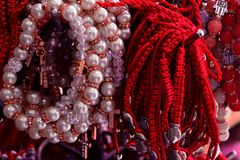 Bracelet braided from red thread and pearls. amulet against the evil eye on wrist from Jerusalem, Israel. Bracelet braided from red thread and pearls. amulet stock photo
