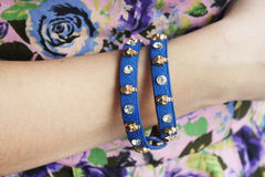 Bracelet. Bright blue bracelet with silver skulls Stock Image