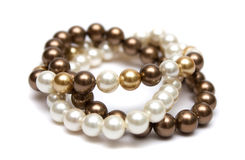 Bracelet of brown, yellow and white pearls. Royalty Free Stock Photo
