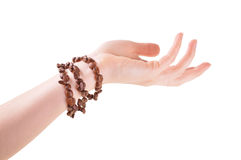 Bracelet from coffee beans on a female hand Stock Photography