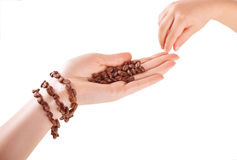 Bracelet from coffee beans on a female hand Stock Photos